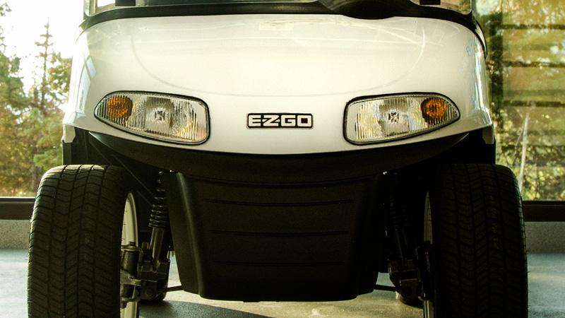 EZGO RXV personal golf cart with bright and safe headlights and taillights accessory