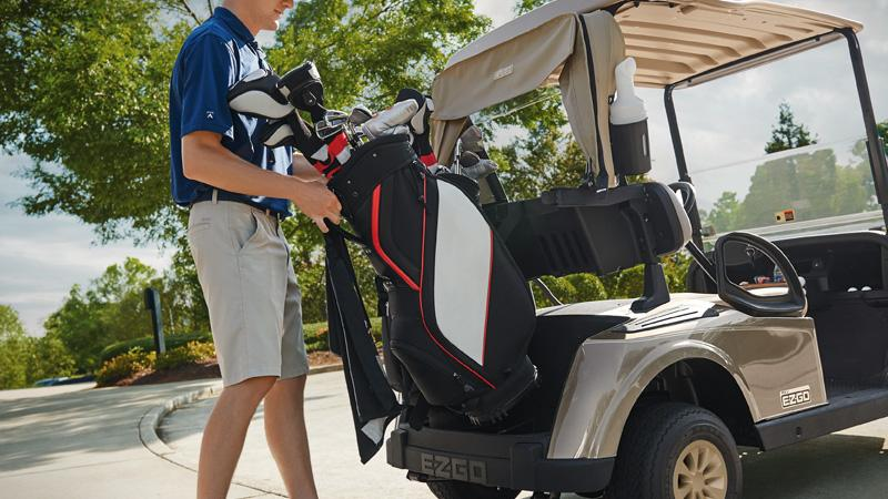 EZGO RXV gas golf cart with golf bag-well for club storage.