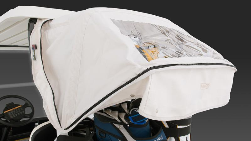 EZGO TXT electric golf cart with golf bag cover for weather protection.