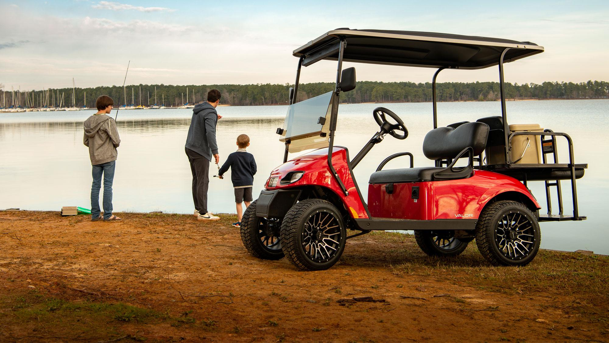 EZGO Red Electric Valor Golf Cart with Top and Tires and Wheels Accessories