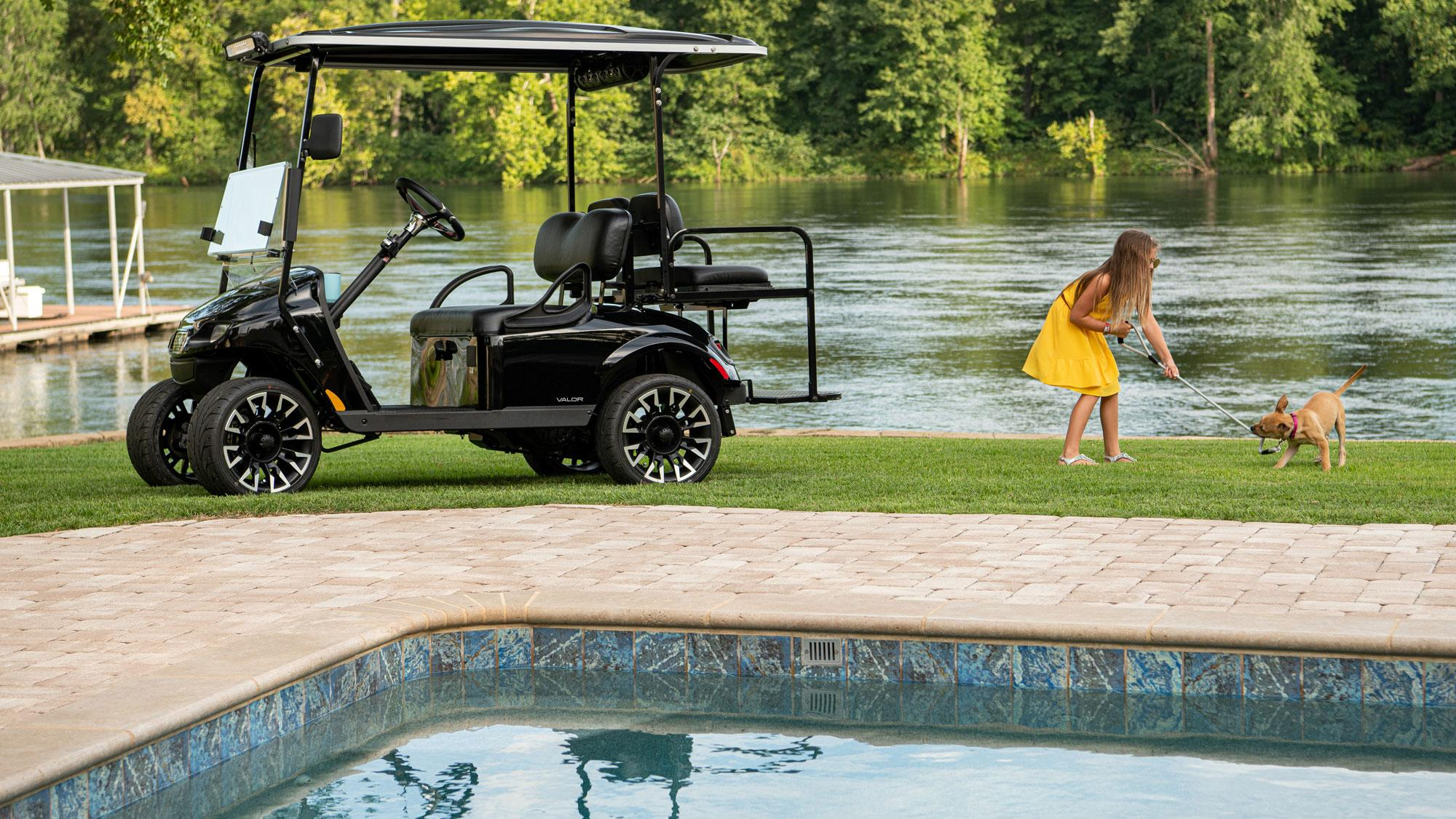 EZGO Black Valor Gas Golf Cart with speakers and windshield accessories